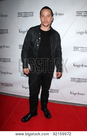 LOS ANGELES - MAY 31:  Travis Aaron Wade at the Angeleno Magazine  June 2015 Issue Party with Cover Man Adrian Grenier at the The Argyle on May 31, 2015 in Los Angeles, CA