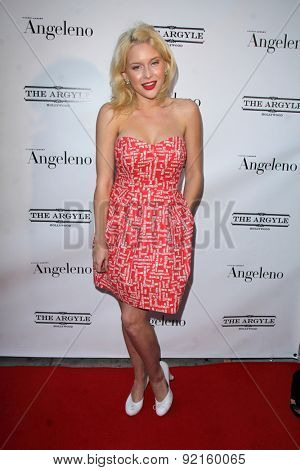 LOS ANGELES - MAY 31:  Renee Olstead at the Angeleno Magazine  June 2015 Issue Party with Cover Man Adrian Grenier at the The Argyle on May 31, 2015 in Los Angeles, CA