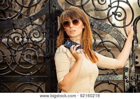 Fashion Girl With Smart Phone Outdoors