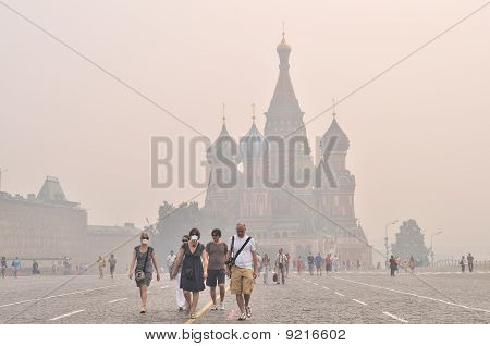 Tourists In Gas Mask On Red Square Under The Smog, Moscow, August 9, 2010
