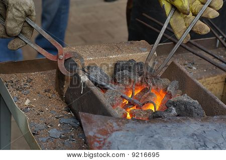 Heating the metal before forging