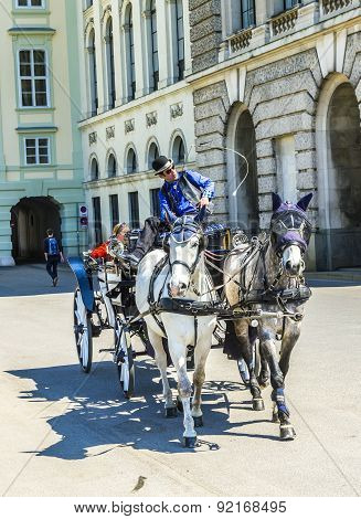 City Center Street View, People Walking And Fiaker With White Horses In Vienna