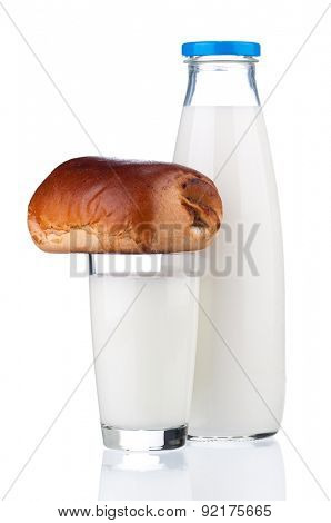 Bottle of milk with bun, isolated on white background