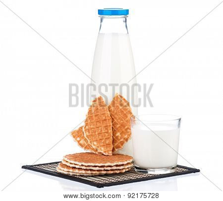 Bottle of milk with fresh wafers, isolated on white background