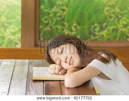 Asian Gir Sleeping While Learning