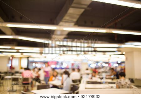 Blurry Defocused Image Of People Eating Food In Food Court For Background