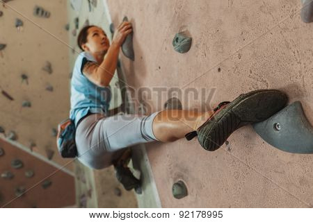 Young Woman Climbing Indoor