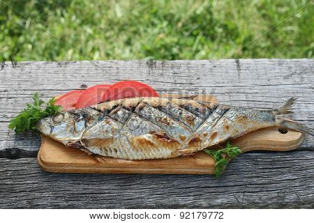 Herring, Grilled, Sliced Tomato And Parsley On A Cutting Boards Closeup O