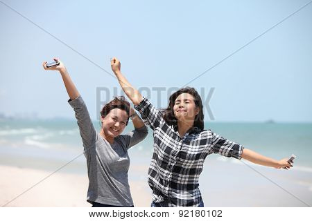Two Woman Feel Happy On The Beac