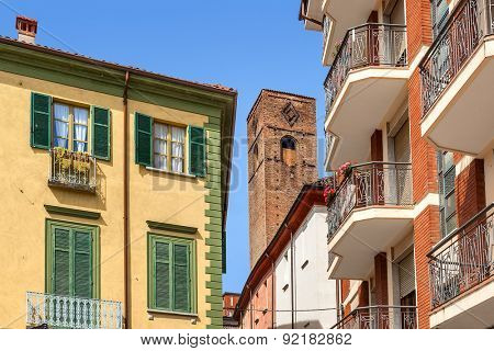 Medieval tower among typical italian houses in town of Alba in Piedmont, Northern Italy.