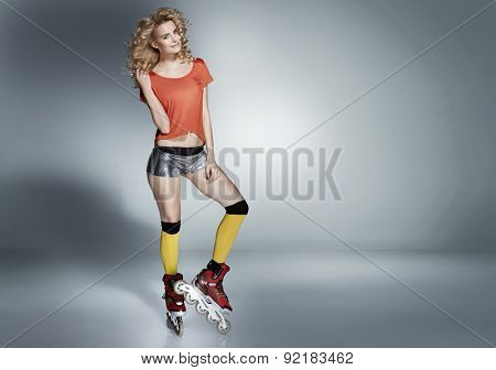 Attractive rollerskating woman
