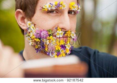 Intense Look Of A Flower Covered Hipster Reading