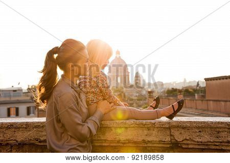 Mother And Daughter In Profile At Sunset With St. Peter's