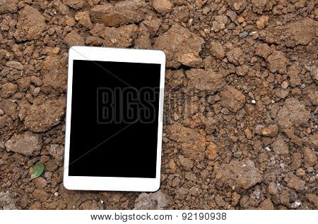 Cell Phone On Soil Surface.