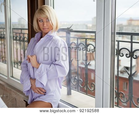 Beautiful Lady Sitting By The Window