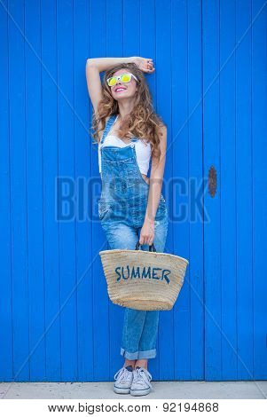 summer teen girl wearing blue denim and sunglasses.