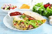 picture of tacos  - Tasty taco with tomato dip on plate and vegetables on table close up - JPG