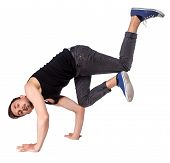 picture of break-dance  - Break dancer doing handstand against a white background - JPG