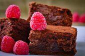 image of brownie  - Home made Chocolate Brownies And Raspberries close up - JPG