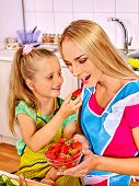 pic of child feeding  - Happy child feed mother  at kitchen - JPG