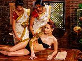stock photo of panchakarma  - Young woman having ayurveda spa treatment - JPG