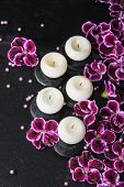 picture of geranium  - beautiful spa still life of geranium flower beads and candles in reflection water closeup - JPG