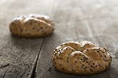 picture of bagel  - Close up of a flax seed bagel over wooden background - JPG