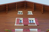 stock photo of chalet  - Tipical Rustic Windows chalet mountain - JPG