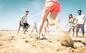 Постер, плакат: Group Of Friends Playing Soccer On The Beach
