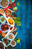 picture of fenugreek  - Various asian spices and herbs on a blue wooden background - JPG