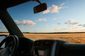 picture of riding-crop  - view from car window on field at sunset - JPG