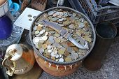 stock photo of flea  - Bunch of Old Coins in Tray at Flea Market - JPG
