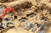 pic of excavator  - Foundation construction work for building showing excavation of excavator - JPG