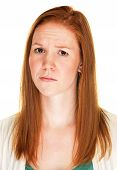 picture of single woman  - Single red haired woman with confused expression - JPG