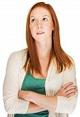 image of snob  - Snobbish red haired young woman with arms folded - JPG