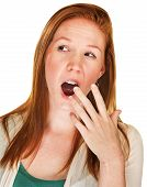 picture of yawn  - Isolated bored young adult woman covering mouth while yawning - JPG