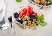 foto of yogurt  - Granola with yogurt and berries in glasses - JPG
