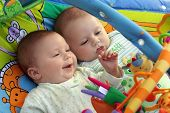 stock photo of twin baby  - two baby boys twin brothers playing together - JPG