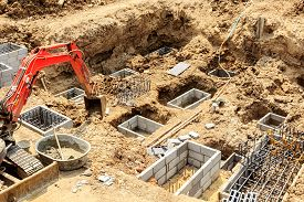 foto of excavator  - Foundation construction work for building showing excavation of excavator - JPG