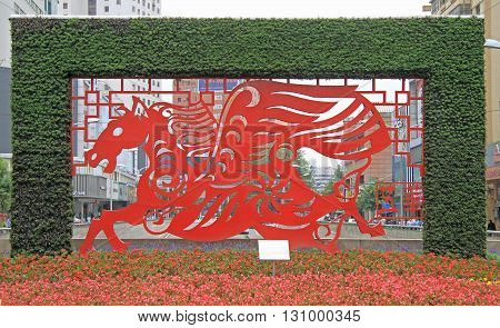 Kunming China - June 8 2015: decorative composition with winged steed in Kunming China