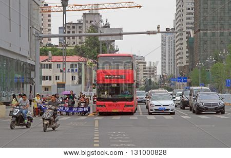 Cars Are Waiting For The Green Signal Of Traffic Light In Kunming, China
