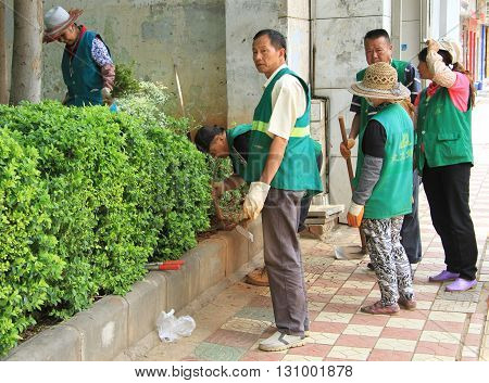 Street Workers Are Doing Some Work Outdoor In Kunming, China