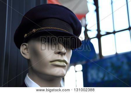 conductor figurine head near the train station