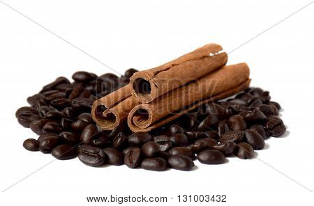 Fragrant cinnamon sticks and roasted coffee beans. / Isolated on white background /. Close-up.
