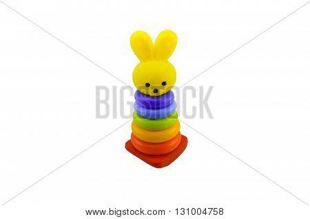 macro multicolored pyramid children's toy a hare a rabbit isolate on a white background