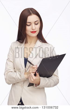 portrait of businesswoman planing or writing something in tablet
