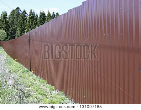 A fence made of brown metal professional flooring