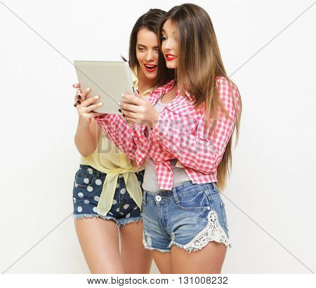 two girls friends taking selfie with digital tablet