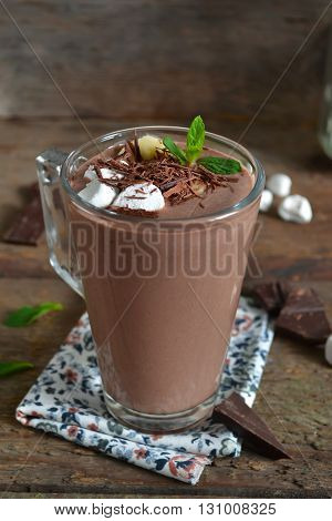 chocolate smoothie with oats and marshmallow on a wooden background
