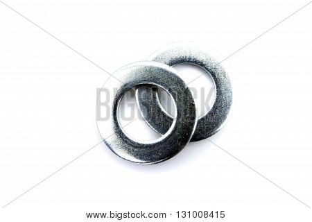 two shining big steel metal washers on white background isolated closeup